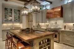 Wrought iron pendants creating a focal point in a French country kitchen.