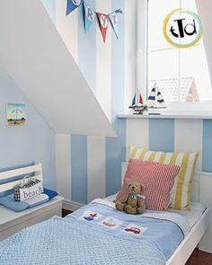 Decorazione a strisce verticali per una simpatica camera al mare!