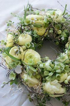a lovely spring flower wreath made even more special with ranunculus Spring Door Wreaths, Easter Wreaths, Summer Wreath, Deco Floral, Arte Floral, Floral Design, Easter Flowers, Spring Flowers, Ranunculus Flowers
