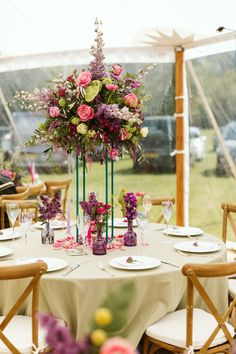 Gorgeous bright wedding flowers by Leafy Couture, image by Freya Raby. Turquoise metal stand and purple and pink flowers complement our sailcloth tent perfectly! Bright Wedding Flowers, Pink Flowers, Marquee Wedding Inspiration, Tall Floral Arrangements, Sailing Outfit, Yurts, Festival Wedding, Window Wall, Wedding Styles