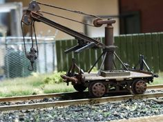 Hand operated & rusted version of a smaller railroad crane.