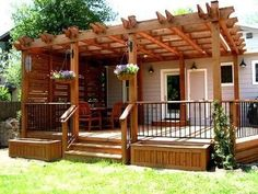 I like this look for a Pergola over my deck. Also those raised flower boxes, would protect my flowers from weed eater.