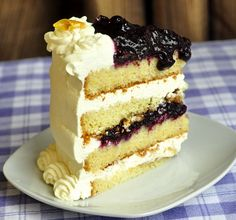 Lemon Blueberry Cream Cake - luscious layers of lemon butter cake, fresh blueberry compote and vanilla whipped cream. An amazing flavor combination for any occasion.