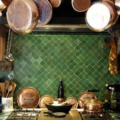 All copper, wooden utensils, and William Sonoma Appliances for the kitchen. Love this green splash