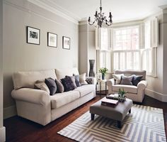 Dark gray couches yellow throw pillows and yellow throws for Living room ideas victorian terrace
