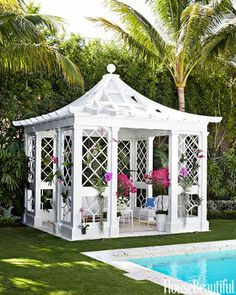 Garden pagoda is a breathtaking poolside focal point via A Whimsical Palm Beach Home by Kemble Interiors- The Glam Pad