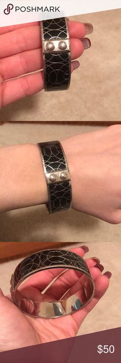 Coach bangle bracelet Coach bangle bracelet! Black & silver. Like new! Easy to layer with other bracelets or perfect alone! Coach Jewelry Bracelets