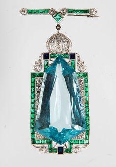 An art deco aquamarine, emerald, sapphire, diamond, and platinum brooch
