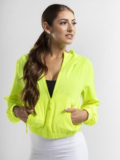 A shorter-length zip-up windbreaker featuring a drawstring hood, long sleeves, and slanted front pockets. Drawstring hood Zip front Front zip pockets Banded bottom Waist length Ideal for workouts & achieving a lux sportswear look Get The Look, Zip Ups, Sportswear, Windbreaker, Long Sleeve, Sleeves, Neon, Lights, Collection
