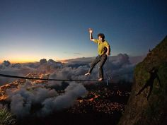 Slackline, Rio de Janeiro. The Brave man crossing mountains in Brazil.