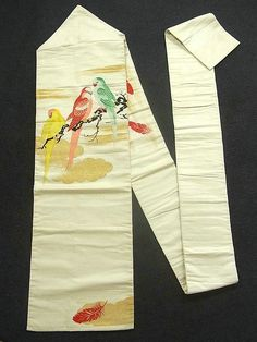 This is a Nagoya obi with 3 vibrant parrot design, which is woven