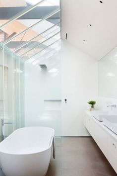 More pane glass, open bathroom layouts, and lots of natural light. Open bathroom inspiration for #ThisOldHouse via www.L-2-Design.com