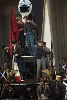 ":Les Mis (2012) | Aaron Tveit (Enjorlas) and Eddie Redmayne (Marius) ""take five"" on set at the Old Royal Naval College, Greenwich, London England."