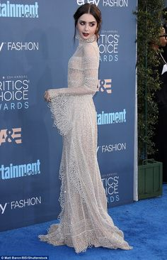 Red Carpet Hair Looks Picture Description Getting it right: Lily Collins stunned in a delicate high-neck dress with gothic hair and Lily Collins Dress, Lily Collins Hair, Lily Collins Style, Gothic Hairstyles, Celebrity Hairstyles, Stylish Gown, Gothic Chic, Red Carpet Looks, Classy Outfits