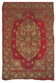 A VELVET FLOORSPREAD   INDIAN, 19TH CENTURY   embroidered in metal thread with pomegranate type palmettes   67in. x 104in. (170cm. x 250cm.)