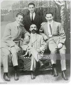Marx Brothers when they played in vaudeville under the name of The Three Nightingales. Left to right, Gummo; Julius Schickler, their uncle who served as manager; and Harpo. Standing is Groucho.