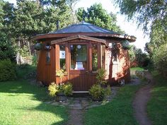Round house made of a recycled whiskey barrel at Findhorn eco-village, Scotland.