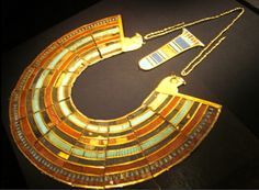 Google Image Result for http://www.sanfranciscosentinel.com/wp-content/uploads/2009/06/inlaid-broad-collar-and-counterweight-gold-carnelian-glass-thebes-valley-of-the-kings-tomb-of-tutankhamun-photo-sean-martinfield2.jpg