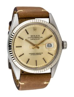 Men's 14K white gold and stainless steel 36mm Rolex Oyster Perpetual Datejust automatic watch with fluted bezel, Pie Pan champagne dial, silver-tone index hour markers, gold-tone sword hands, cyclops date display at 3 o'clock position, fluted crown, beige leather strap and tang buckle closure.  Note: This watch has been evaluated by our Watch Specialist and Horologist.   Collection: Oyster Perpetual Model Name: Oyster Perpetual Datejust Reference Number: 1601 Serial Number: 3393792…