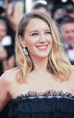 Ludivine Sagnier wearing earrings and a ring in white gold, pink gold and diamonds from the new Insolence collection by Chaumet for the Cannes 70th Anniversary celebrations