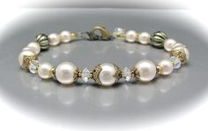 Wedding Pearl Bracelet Cream White Swarovski Crystal Pearls Crystal AB Victorian Style. $36.00, via Etsy.