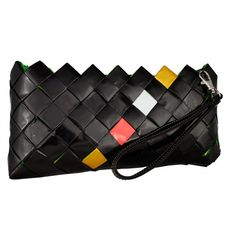 Ecochic Line candy clutch bagmade of interweaved candy wrappers wrongly printed and so meant to be discarded.