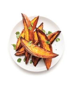 Jazz up the roasted potatoes with lime zest and cilantro for a zingy twist. Get the recipe for Crispy Roasted Sweet Potatoes With Lime and Cilantro.