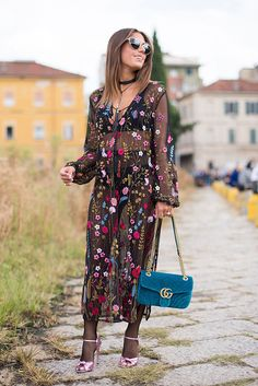 Milan Fashion Week attendee Annacarla Dall'Avo bringing it in a sheer embroidered maxi dress and Gucci accessories