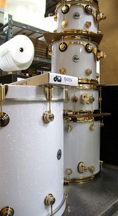 """White Glass FinishPly with Gold Hardware by DW . . . . . THIS is the """"snow bank sparkle/glitter"""" finish I've seen in my mind eye for the last DECade . . . Lose the gold hardware, though. Too showy."""
