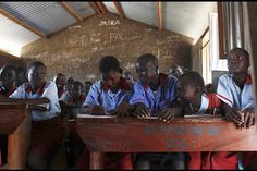 Students attend a lesson at a public school in Gudele on the outskirts of South Sudans capital Juba. One in four people are literate in South Sudan.
