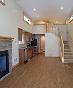 On the main floor is a large living room with fireplace, master bedroom with queen size bed, and a full bathroom with a solid surface counter.