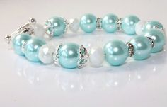 I like the pearl/tiffany blue/silver look! Might have to think about going with silver instead of chocolate!