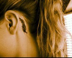 Feather ear tattoo