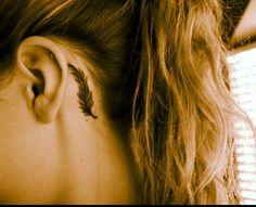 Feather ear tattoo