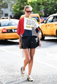 50 Outfits That Prove 2014 Was Officially the Year of Sneakers: Sure, we love our stilettos and have a soft spot for a fancy pair of flats, but the one pair of shoes we continued to reach for over and over again this past year?