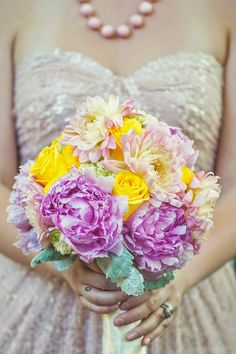 Gorgeous bridal bouquet paired with a pink sequins bridal gown