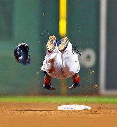 Manny Ramirez flies into second base after doubling, losing his helmet in the process. Ramirez went 2-for-4 but Boston lost 6-5.