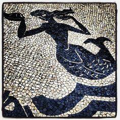 Mermaid on the sidewalks of Lisbon.