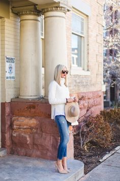 Classic Ivory Turtleneck Sweater and distressed denim
