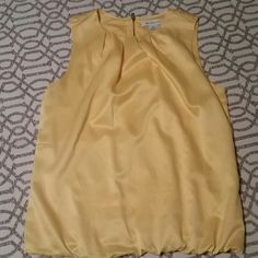 Yellow top Yellow dress tank from Liz Clairborne. Top is doubled lined and has an elastic band at the bottom. Bought from another posher but it's a tad too small from me. Last posher said she wore it once or twice. Liz Claiborne Tops Blouses