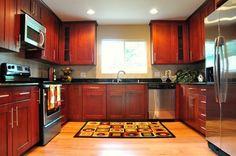cherry shaker cabinet, red oak hardwood floor, black galaxy granite counter, tile backsplash