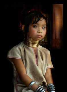 Amazing beauty Northern Thailand Her culture hangs delicately upon those rings on her neck.  Her beauty whispers softly to the viewer of her culture's created dilemma.