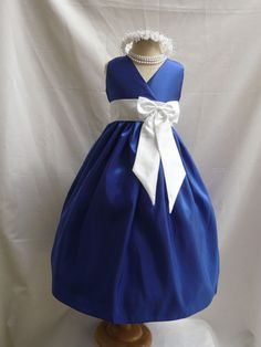 blue flowergirl dress with a very pretty bow.  @Dani padilla idk if you're having a flower girl but that would be perfect with an orange bow