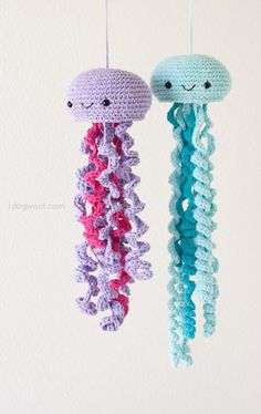 Crochet a family of jellies to hang in an ocean-themed nursery.