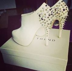I would go with these heels because they match the Hip Hop style and would look great with the studded hat.