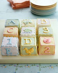 "These ""building blocks"" -- ideal for a baby shower or first birthday -- are covered with fondant and decorated with royal icing. One sheet-cake recipe will make twelve scrumptious blocks."