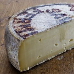 Tomme de Savoie - don't know what kind of cheese this is but want to try.