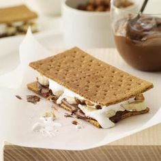 Banana-Nutella S'Mores Recipe - Delish.com -Substitute the banana for strawberries and I think would be awesome!