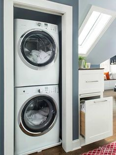 A washer and dryer slide into a niche across from the closet for easy-access laundry. The adjacent cabinet stores detergent in the top drawer, while dirty laundry goes in the hamper below. Other Tucked-Away Laundry Rooms/