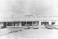 """Bodiddle's - My grandfather liked to stop into this """"grocery store"""" on occasion.  As I was often his charge, I skipped into this legendary establishment behind him.  I don't remember the grocery part, but I do remember bar stools, ice cold root beers (and beers) with tissue papers wrapped around them!  """"Bodiddle's Grocery on Hwy. 288 around 1959, near 332 where cloverleaf highway is now in Freeport, Texas - COPYRIGHT INFORMATION ~  Image courtesy of the Brazoria County Historical Museum."""" Old Pictures, Old Photos, Freeport Texas, Brazoria County, Tissue Paper Wrapping, Visit Texas, Lake Jackson, Diy Shops, Historical Pictures"""